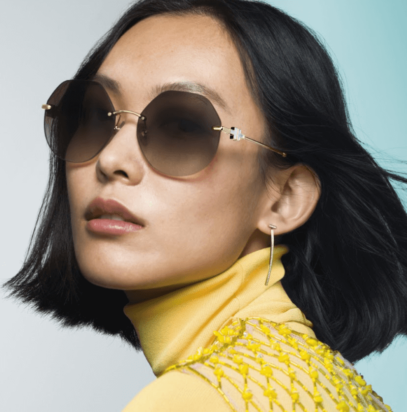 Woman in yellow with glasses